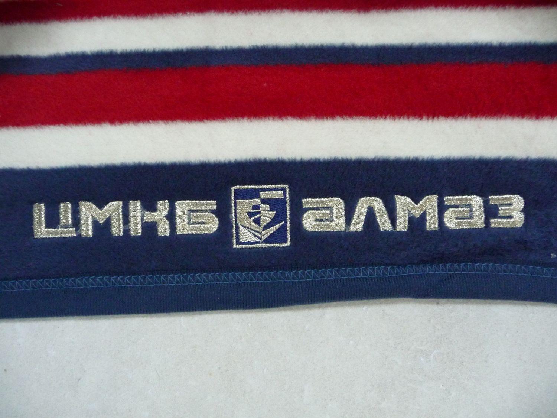 Вышивка логотипа на пледе 96
